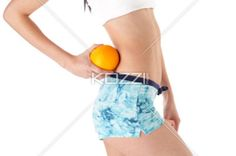 side view of a young woman holding orange. - Side view cropped image of a young woman holding an orange, Model: Adriana Chira