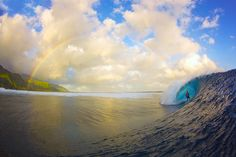 Christian Redongo surfs a wave with a rainbow in the background, in Teahupoo, Tahiti, French Polynesia. This award-winning picture shows land and sea linked by a rainbow. The surfer may have been left wondering whether a pot of gold could be under his board at the bottom of the ocean. 26-year-old photographer, Zak Noyle from Honolulu, Hawaii, scooped the Surfer Magazine 2011 best photo of the year competition for this picture.