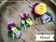 Realistic, artificial floral boutonniere and corsage set. Yellow roses, purple hydrangea, and lavender lisianthus. One corsage and two boutonnieres.