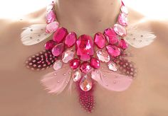 I based this piece off of a necklace that I designed and made years ago. I got some more pink feathers so I started playing! Pink Feather and Rhinestone Statement Necklace Feather Jewelry, Feather Necklaces, Feather Earrings, Statement Necklaces, Diamond Pendant Necklace, Rhinestone Necklace, Necklace Extender, Feather Crafts, Pink Feathers