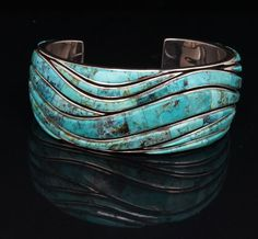Earl Plummer, winner of the Best of Jewelry award at the 2013 Santa Fe Indian Market, is showing his talent in design as well as workmanship. This bracelet is inlaid with turquoise from the Blue Diamond mine. It is stunning! Blue Diamond turquoise has not been mined since the 1970's, so it is difficult to obtain.