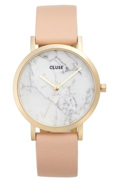 Unique patterns in the genuine stone dial celebrate your individuality on this minimalist round watch held by a soft leather strap.