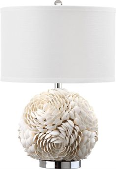 This lamp is perfect for a beach house! Shell artistry reigns in the distinctive base of the romantic Pauley table lamp. With large open blossoms crafted of individual seashells, this unique transitio