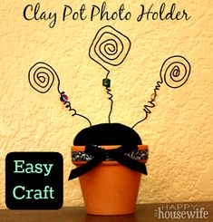 By contributing writer Sara. This cute little clay pot photo holder is a perfect easy spring craft! Few materials, little cost, and a lot of versatility! We made these at my MOPS group last week Clay Pot Crafts, Wire Crafts, Crafts To Make, Easy Crafts, Crafts For Kids, Picture Holders, Photo Holders, Camping Crafts, Craft Night