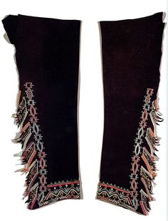 18th century Iroquois leggings on dyed deerskin, decorated with either porcupine quills or moosehair embroidery, trade beads and silk ribbon work. National Museum of the American Indian.