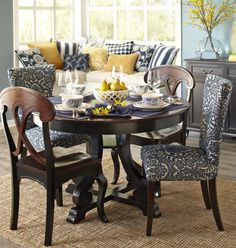 These blue damask chairs slipped in with their wooden cousins invite diners to make themselves comfortable