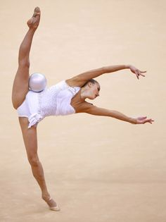 Ukraine's Ganna Rizatdinova competes using the ball in her individual all-around gymnastics qualification match (London 2012).