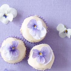 "Mini Coconut Cupcakes with Passion Fruit Icing I ""Passion fruit infuses the icing with real tropical flavor."""