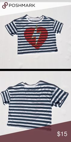 Navy Stripes Thunder-heart Crop Top This is a crop top with navy stripes. There is a thunder-heart pattern at the front. Tops