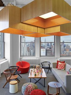 A stool by Patrick Norguet and a barrel chair by Busk + Hertzog sit at opposite ends of the lounge at the New York office of Hudson Rouge by M Moser Associates. Photography by Eric Laignel. Interior Design Magazine, Office Interior Design, Corporate Interiors, Office Interiors, Commercial Interior Design, Commercial Interiors, New York Office, Workspace Design, Barrel Chair