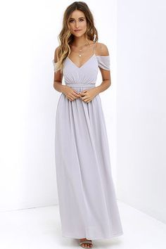 Romantic and utterly enchanting, our Quite the Charmer Grey Maxi Dress will put a bit of magic in every step you take! Slender straps support a lightly padded triangle bodice, made of Georgette fabric that flutters off the shoulder. From a banded waist, gathered accents transition into a full maxi skirt. Hidden back zipper with clasp.