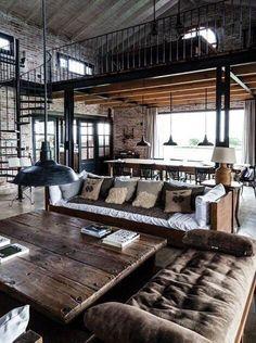 Casa rústico-industrial. Lámparas industriales a diferentes alturas.
