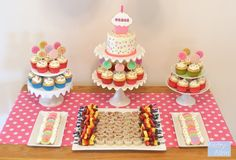 like the cake on one level and cupcakes on the other..and live the idea of fruit kabobs and little sandwiches (but may do the sealed circle type using pampered chef tool)