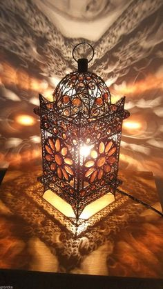 This is a stunning Moroccan style,fantastic quality lantern/table lamp. Red/Bronze metal with acrylic amber coloured beads in a lovely cutout flower design over it. Gives a lovely low light and creates a great ambiance to any room.when lit gives out a beautiful shadow effect on the walls around it. | eBay!