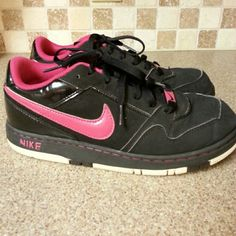 Black and Pink Nike Sneakers Have been worn but still in great condition. They are size 6Y but fits size 7 1/2 in women's Nike Shoes Sneakers