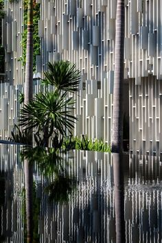 Architectural Materials // The facade is composed by lattice patterns alternated with vertical landscapes that filter the strong tropical sunlight into a pleasant play of light and shadow on the textured walls at the Naman Spa by MIA Deisgn Studio: