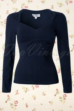 This 50s Aubree Long Sleeve Stretch Top Navy from Miss Candyfloss is a lovely 1950s retro style top in dark blue.This top has a striking sweetheart neckline and pointy wrappers which make it look like a cute bolero! The pleats at the bust make this top suitable for all cupsizes. Made from a super soft and stretchy navy cotton blend for a perfect fit. The long sleeves make this the ideal top for this season! Nice to pair with our pencil skirts and trousers!