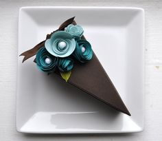 Chocolate cake with two-toned blue flowers.  It's made of paper!