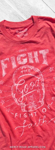 """Christian T-Shirt with vintage boxing theme and scripture 1 Timothy 6:12 """"Fight the good fight of faith."""" This faith shirt is handcrafted and screenprinted on a gloriously comfy red triblend tee. Quality Christian clothing for women and men. FREE SHIPPING USA. Shop >> MercyRoadApparel.com"""