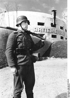 A German soldier stands guard in front of a defensive bunker installation built by the Organisation Todt as part of the Atlantic Wall at Cap Gris Nez, France. Ww2 History, History Photos, Military History, Ww2 Photos, Bunker, Germany Ww2, Templer, The Third Reich, German Army
