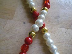 White,Red Pearls gold spacer, with Ruby Crystals