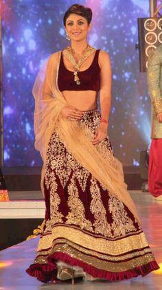 Shilpa Shetty Walks The Ramp In Maroon Lehenga At IBBS by Vendorvilla.com