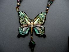Mariposa butterfly necklace.. Stamped black clay, pearlex powders, sanded and glazed