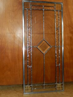 Door for a wine cabinet