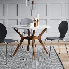 Make a mid-century style statement in your kitchen with the Emmond Mid-Century Round Dining Table from Project 62™. This two-tone dining table brings together the clean, angular lines and simple shapes that are a hallmark of the mid-century style. Complete the entire look by pairing it with complementing chairs and placing an area rug underneath.<br><br>1962 was a big year. Modernist design hit its peak and moved into homes across the country. And in Minnesota, Target was...