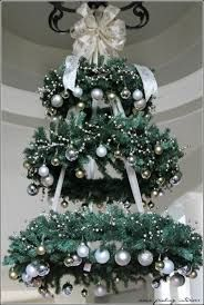 Christmas tree chandelier -  loungeroom in turquoise, silver and red.