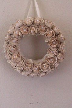 Vintage Inspired Novel Wreath~Hand rolled roses crafted from book pages and adorned with a single pearl in the middle make up this beautiful piece! Comes with a ribbon for hanging..just unbox and hang!