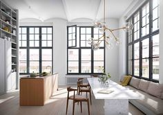 CH20 Elbow Chairs in modern Scandinavian loft apartment. Light by Lindsey Adelman