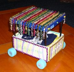 Now this float has Bling- canapy of beads for this shoe box parade float!