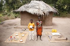 Daily Life: Siblings - (Left-right) Paulino, 7, and Laura, 14, stand beside their belongings, all of which are displayed on their sleeping mats outside the small thatched-roof hut of their child-headed household, in the community of Mudurini in Maganja da Costa District in Zambézia Province of Mozambique.  An estimated 1.6 million Mozambican children are orphans, many due to HIV/AIDS.  2007 © UNICEF/Roger LeMoyne - http://www.unicef.org/photography