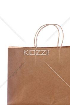 paper shopping bag displayed on white. - Close-up shot of a paper shopping bag displayed on white.