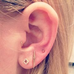 The Tragus + Triple Lobe | 28 Adventurous Ear Piercings To Try This Summer