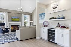 Beechwood Homes - This fresh, open floor plan appeals to the 55+ home buyer. And we love the wet bar! #openfloorplan #wetbar #freshdesign #modelmerchandising