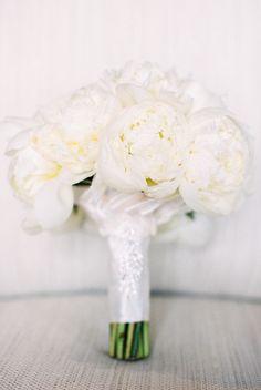 Classic ivory peony wedding bouquet: http://www.stylemepretty.com/california-weddings/goleta/2017/01/12/ballroom-wedding/ Photography: Michael and Anna Costa - http://www.michaelandannacosta.com/