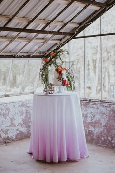 ombre cake table - photo by Jenna Brianne Photography and Sarah Brookhart Photography http://ruffledblog.com/colorful-greenhouse-wedding-ideas