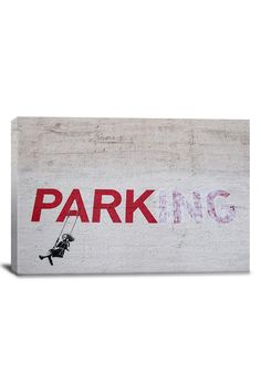 i took a photo of this banksy graffiti in a parking lot downtown la months ago.  last weekend, a man was selling this picture on canvas along the venice strand!  bought it.