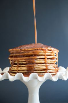 Churro pancakes made with cinnamon and sugar, covered in brown butter and cinnamon infused maple syrup. Mmmm!
