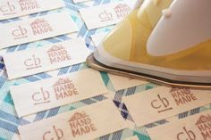 print on cloth (or twill tape) by stamping with acid free ink (intended for paper) on your cloth and heat setting with an iron.