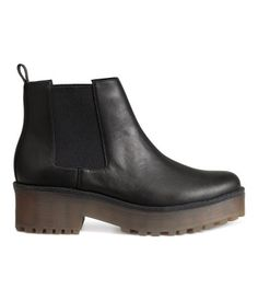 $49.99-Chelsea boots in imitation leather with a platform, elastic panels at sides, and chunky rubber soles. Front platform height 1 1/4 in., heel height 2 in.