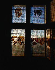 Edinburgh Castle, Scotland - stained glass windows depicting coat of arms in the banqueting hall.