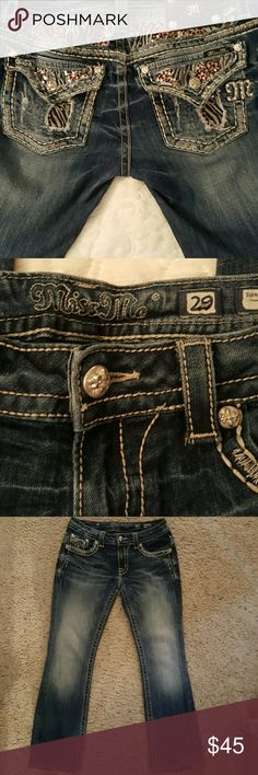 Miss Me jeans Jungle like pattern with distressed look on pockets. Faded wash on front. Beautiful jeans! Length from top of jeans to bottom of cuff is 36 1/2. And from inseam of crotch is 28 inches. Like new. Miss Me Jeans Boot Cut