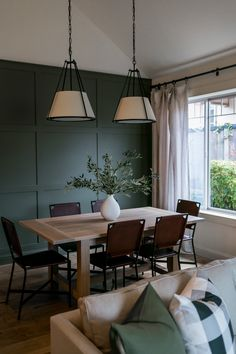 Dining room design + accent wall + green accent wall + wooden dining table + leather dining chairs + pendant lighting + open to living room + paneled wall Green Dining Room, Living Room Green, Dining Room Walls, Dining Room Design, Home Living Room, Living Room Decor, Living Room Wall Lighting, Lights For Living Room, Dinning Room Paint Colors