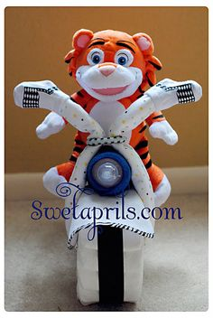 {DIY-How to Make a Diaper Motorcycle}  - Something different other than the usual Diaper Cake...I am soooooo going to do this for my sister in law for her baby shower in April!!! It's a boy!!! Yay!!!! ;c) xxox