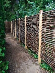 Woven twig fencing. It provides privacy and security with a more natural look than treated lumber