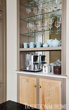 A mirrored back behind the shelves of the furniture-like cabinet and coffee bar bounces light and adds a touch of glamour. - Photo: Werner Straube / Design: Christopher Peacock
