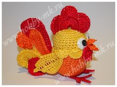В этом мастер-классе мы предложим вам схему отдельных вязаных элементов для создания Огненного Петушка из киндер-яйца. Расскажем, как объединить элементы в одну веселую игрушку.  Такой вязанный крючком петух может не только служить игрушкой, но и украсить рождественское дерево, детскую коляску или послужить декором к Пасхе.  Для работы понадобятся:   нитки «Ирис» оранжевого, желтого, красного и белого цвета; иголка с нитками в тон пряже; 2 пайетки для глазок; ножницы; крючок 0,6 мм…